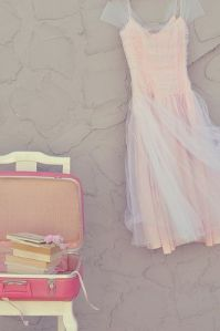 pink dress and suitcase
